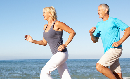 Photo of two adults jogging