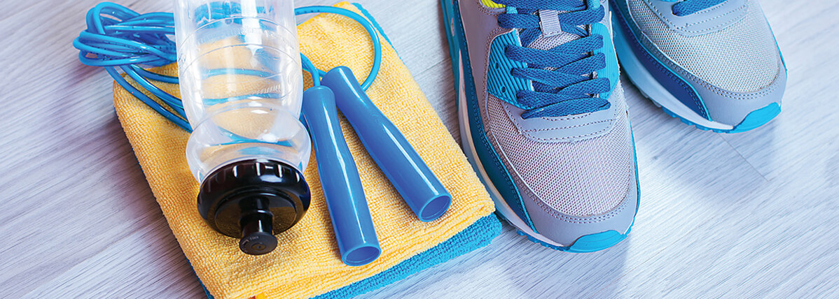 Photo of fitness equipment, running shoes, towel